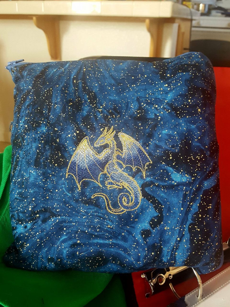 *squee* I'm on a completion high! I made this bag to carry my cross stitch in a little more safely to and from work. The dragon is intended to look like a constellation emerging from the stars.  I didn't have quite the right blues to pull that off the way I wanted but is pretty. Her linework is done in metallic gold to match the stars behind her.  I want to go back for more fabric lol.